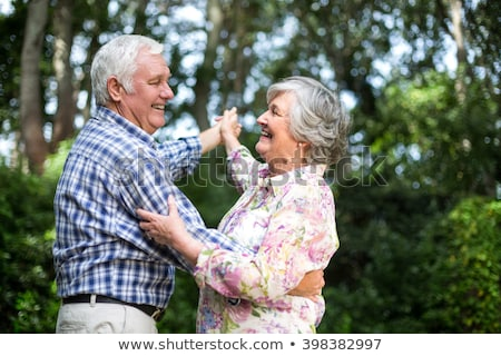 side view of active senior couple dancing together on the beach at dusk stock photo © wavebreak_media