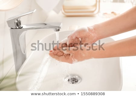 Young woman in the bathroom of a contemporary apartment Stock photo © boggy
