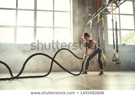 Nő crossfit sportos fiatal nő kötél sötét Stock fotó © choreograph