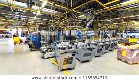 Working at production line of printing plant Stock photo © pressmaster