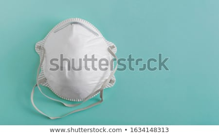 Human protection with medical respirator mask on face. Human anatomy of the respiratory system. Medi Stock photo © ESSL