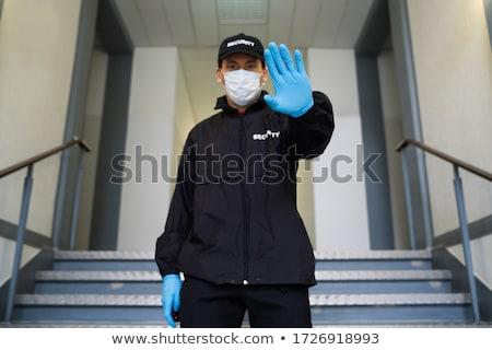 Biztonsági őr arc maszk készít stop kézmozdulat Stock fotó © AndreyPopov