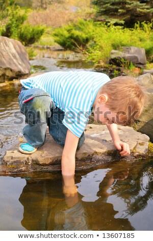 boy has lowered  hand in  stream Stock photo © Paha_L
