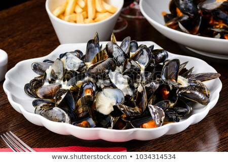 delicious mussels in cream sauce Stock photo © wjarek