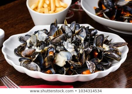 delicious mussels in cream sauce stock photo © wjarek