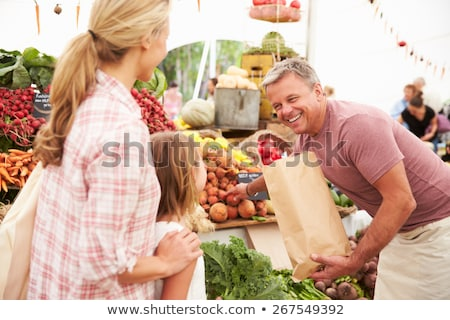 Stok fotoğraf: Mother And Daughter Shopping At A Farmers Market
