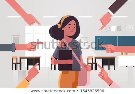 portrait of a schoolgirl being in a classroom at school with her stock photo © hasloo