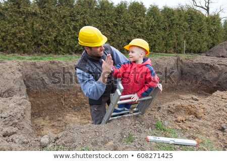 Construction worker and young helper Stock photo © photography33
