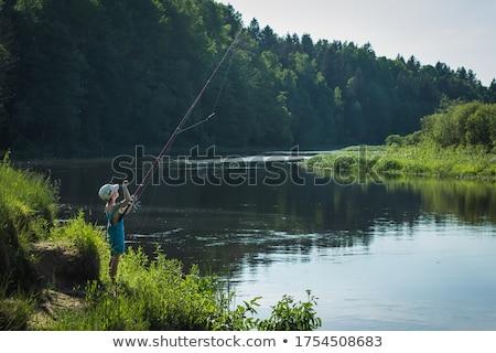 Pescatore snapshot orgoglioso posa foto Foto d'archivio © stevemc
