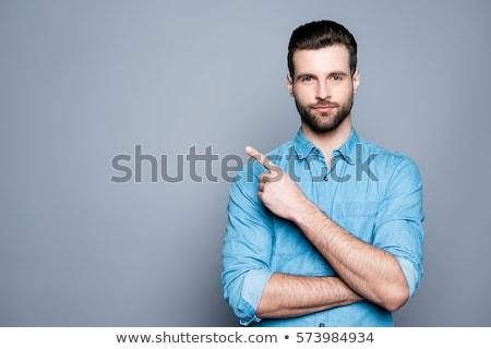 glimlachend · zakenman · wijzend · weg · knap · corporate - stockfoto © stockyimages