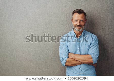 Upbeat businessman with arms folded Stock photo © photography33