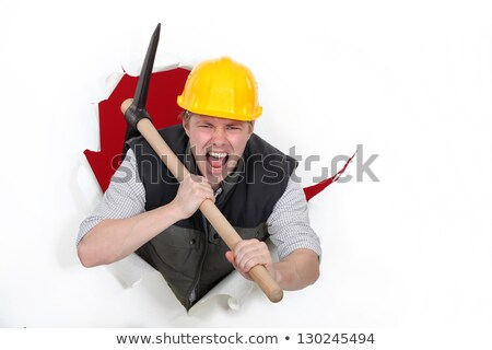 Tradesman bursting through a barrier Stock photo © photography33