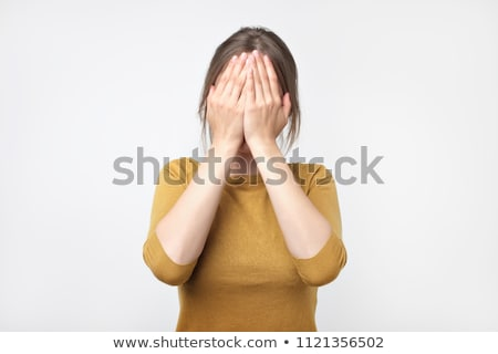 Woman covering face with hands Stock photo © photography33