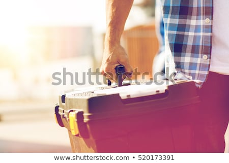 Builder holding tool box Stock photo © photography33