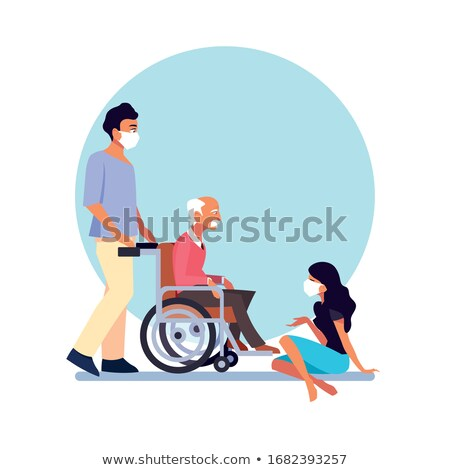hospital worker taking care of senior patient in a wheelchair Stock photo © photography33