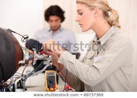 a female technician working on a copper tube Stock photo © photography33