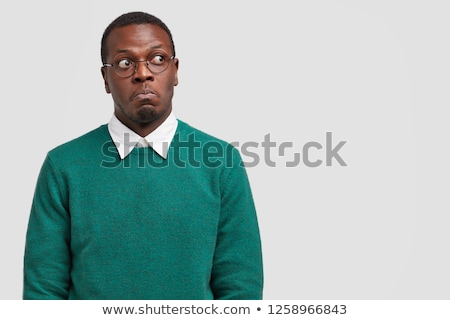 Stock photo: young african man with dark skin looking