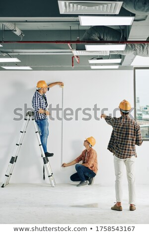 A mature foreman taking measure. Stock photo © photography33