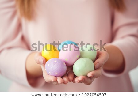 happy ethnic woman showing easter eggs stock photo © wavebreak_media
