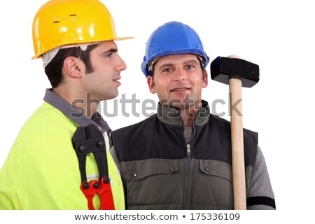 Stock photo: duo of male carpenters against studio background