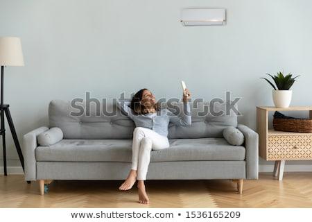 Nő tart távirányító kép fiatal nő mosoly Stock fotó © Ronen