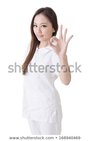 Gülen Asya hemşire vermek tamam imzalamak Stok fotoğraf © elwynn