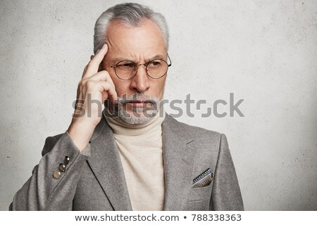 business man with finger on the temple Stock photo © photography33