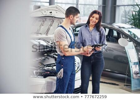 Dealer speaking to a woman in a dealership Stock photo © wavebreak_media