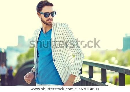 Lezser 30-as évek fickó napszemüveg kaukázusi férfi Stock fotó © eldadcarin