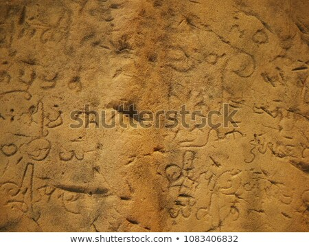 Hieroglyphs on the stone tablet in an old Buddhist temple Stock photo © pzaxe