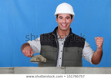 Portrait of a mason busy constructing a wall Stock photo © photography33