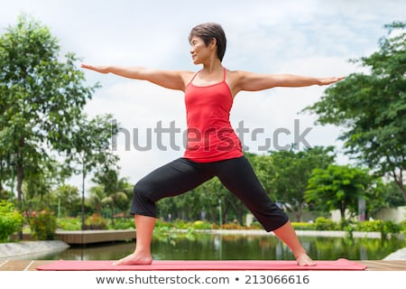 Asian senior woman practicing yoga Stock photo © szefei