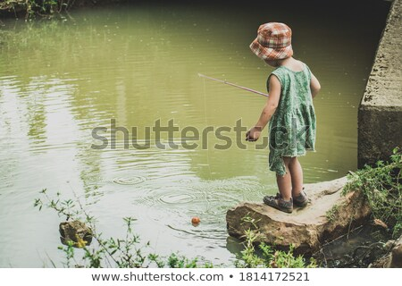 Young girl waiting for fish to bite  Stock photo © tab62