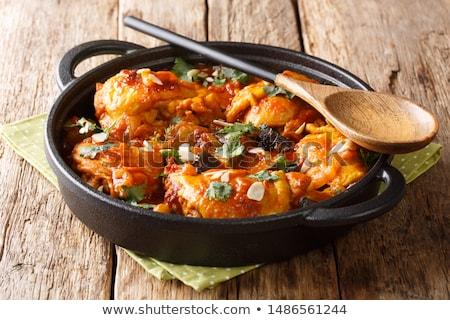 пряный куриные томатный тушеное мясо блюдо таблице Сток-фото © travelphotography