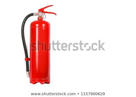 Férfi tart tűzoltó készülék izolált fehér férfi fehér Stock fotó © pxhidalgo