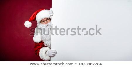 happy santa man presenting big blank board stock photo © feedough