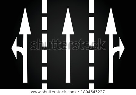 arrows and lines on the asphalt to indicate the direction of dri Stock photo © meinzahn