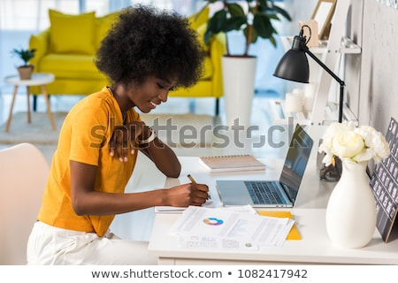 Business woman with yellow paper notes Stock photo © iko