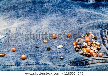 Light blue ripped jeans with rhinestones Stock photo © alekleks
