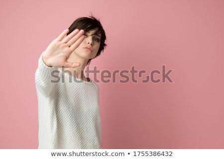 孤立した · 若い女性 · 一時停止の標識 · フォーカス · 手 · 女性 - ストックフォト © bmonteny