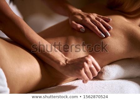 Chinese Woman having wellness massage with essential oils Stock photo © Kzenon