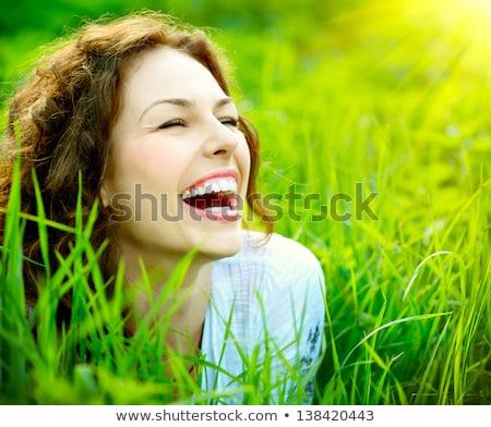 boldog · nő · hazugságok · gyep · másfelé · néz · lány - stock fotó © deandrobot