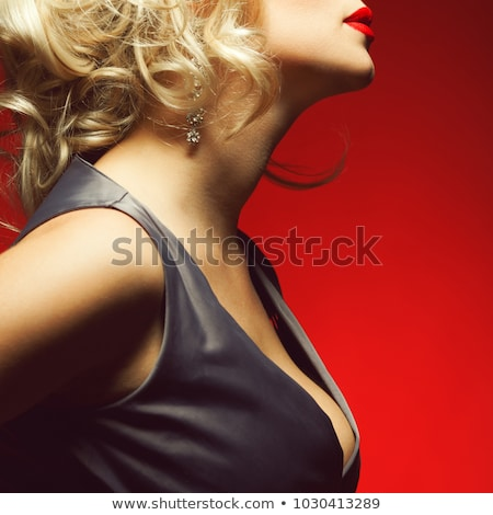 Beautiful blond model  with long curled hair. Makeup. Jewelry. S Stock photo © Victoria_Andreas