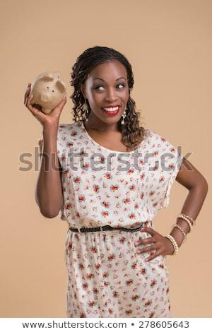 African woman moneybox Stock photo © HASLOO