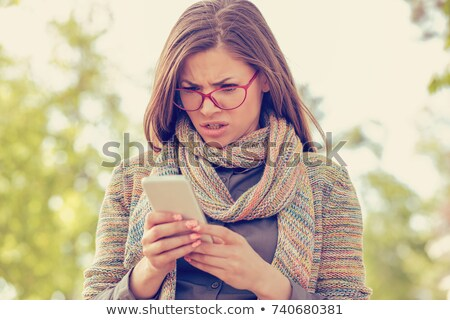 doubtful woman looking mobile phone Stock photo © Giulio_Fornasar