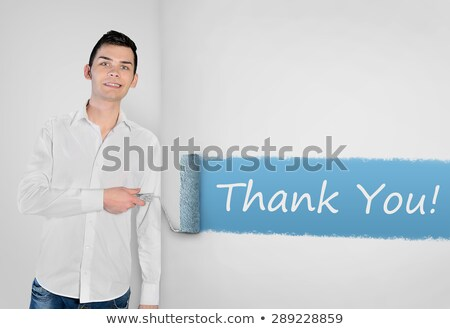 Man painting Thank you word on wall  Stock photo © fuzzbones0
