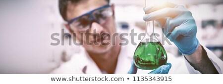 Químico vaso verde químicos laboratorio Foto stock © wavebreak_media