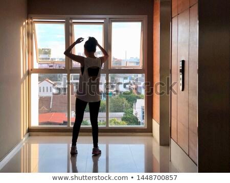 A person performing yoga inside a house  Stock photo © shawlinmohd