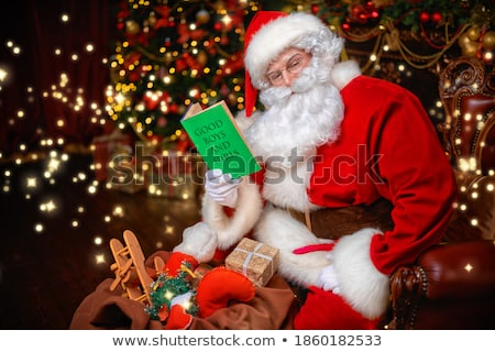 Stock photo: Santa Claus notebook for good children wish list