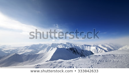 Rocks in snow at nice sun day Stock photo © BSANI